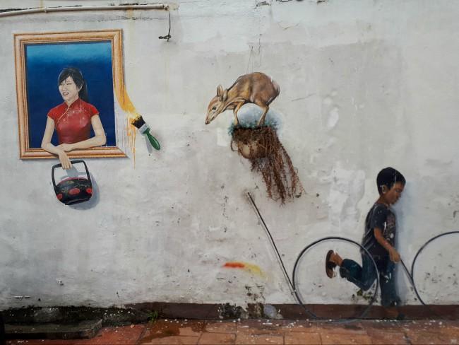 Zoek naar humoristische street art in Malakka